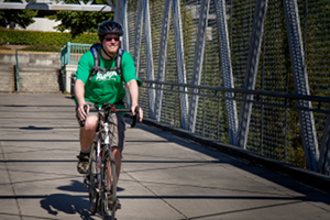 Seth cycling toward the steel bridge in Portland
